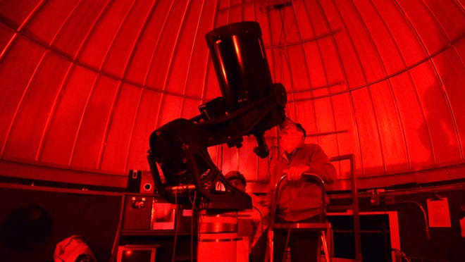 Joey Reece, vice-president of the Shenandoah Valley Stargazers, uses the telescope inside the Stokesville Observatory on Saturday, Oct. 5, 2014.