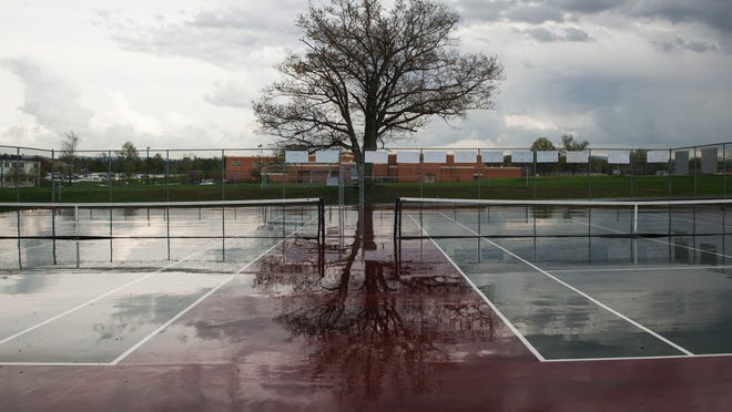 The rain soaked tennis court at Wilson Memorial caused matches to be delayed on Monday, April 20, 2015.