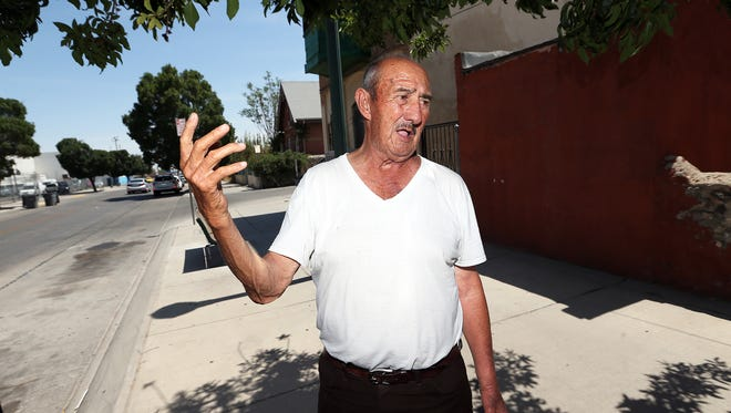Hector Franco, 77, talks outside his Duranguito neighborhood apartment where he lives with his wife and father-in-law, who is 97. He is unsure where they will settle when they have to leave. Most of the neighbors around him have already left, he said.