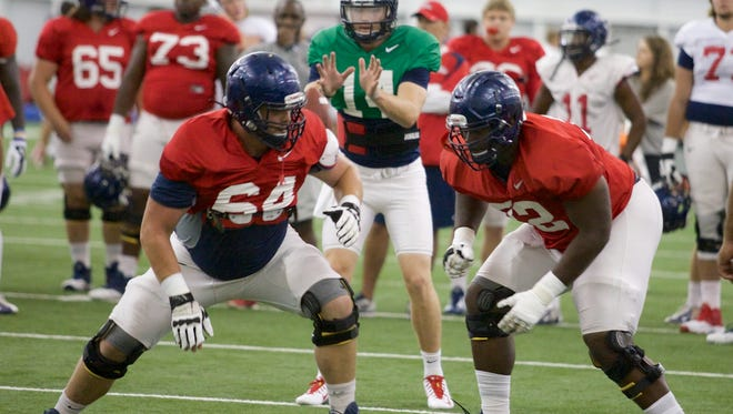 Ben Still and Aaron Morris protect Bo Wallace on the front line.
