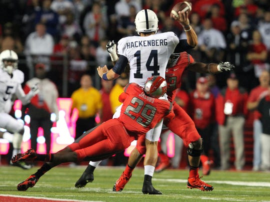 Rutgers' Davon Jacobs (29) tackles Penn State quarterback Christian Hackenberg (14) during Saturday's game in Piscataway.
