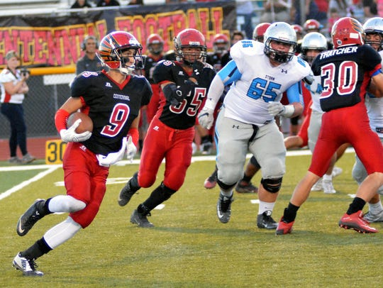Centennial's Brenden Padilla goes around the end against