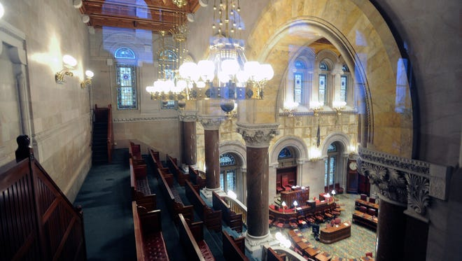 View of an empty Senate Chamber as legislative leaders work on the state budget at the state Capitol on Sunday, April 2, 2017, in Albany, N.Y.