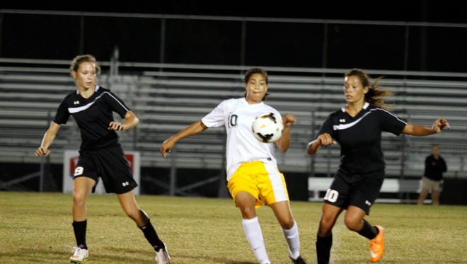 Northwest High School's Alisha Sell (center) scored the first of the Lady Vikings' two first-half goals Tuesday as they won a close match over Kenwood 2-1.