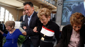 Singer Bruce Springsteen walks off the stage with, from left, his aunt Dora Kirby, 90, mother Adele Springsteen, 85, and aunt Ida Urbelis, 87, after being honored at the Ellis Island Family Heritage Awards Thursday, April 22, 2010 on Ellis Island in New York.