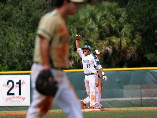 Erick Chavez celebrates a two-run double during the Stingrays' fifth inning rally in the 2A regional final against Keswick Christian at Seacrest Country Day School on Wednesday, May 17, 2017. With the win, the Stingrays advance to the state semifinal against Deltona-Trinity Christian at Hammond Stadium on May 24.