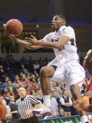Belmont's Ian Clark (21) scores two as Belmont wins