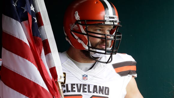 Cleveland Browns' Joe Thomas waits with an American flag to run onto the field before the game against the Philadelphia Eagles, Sunday on Sept. 11, 2016, in Philadelphia.