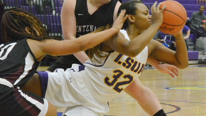 LSUA's Khaila Stampley (32, front right) passes the ball against Centenary's Jessica Brunti (55, back) and DeiAnna Hall (10, left) Tuesday.