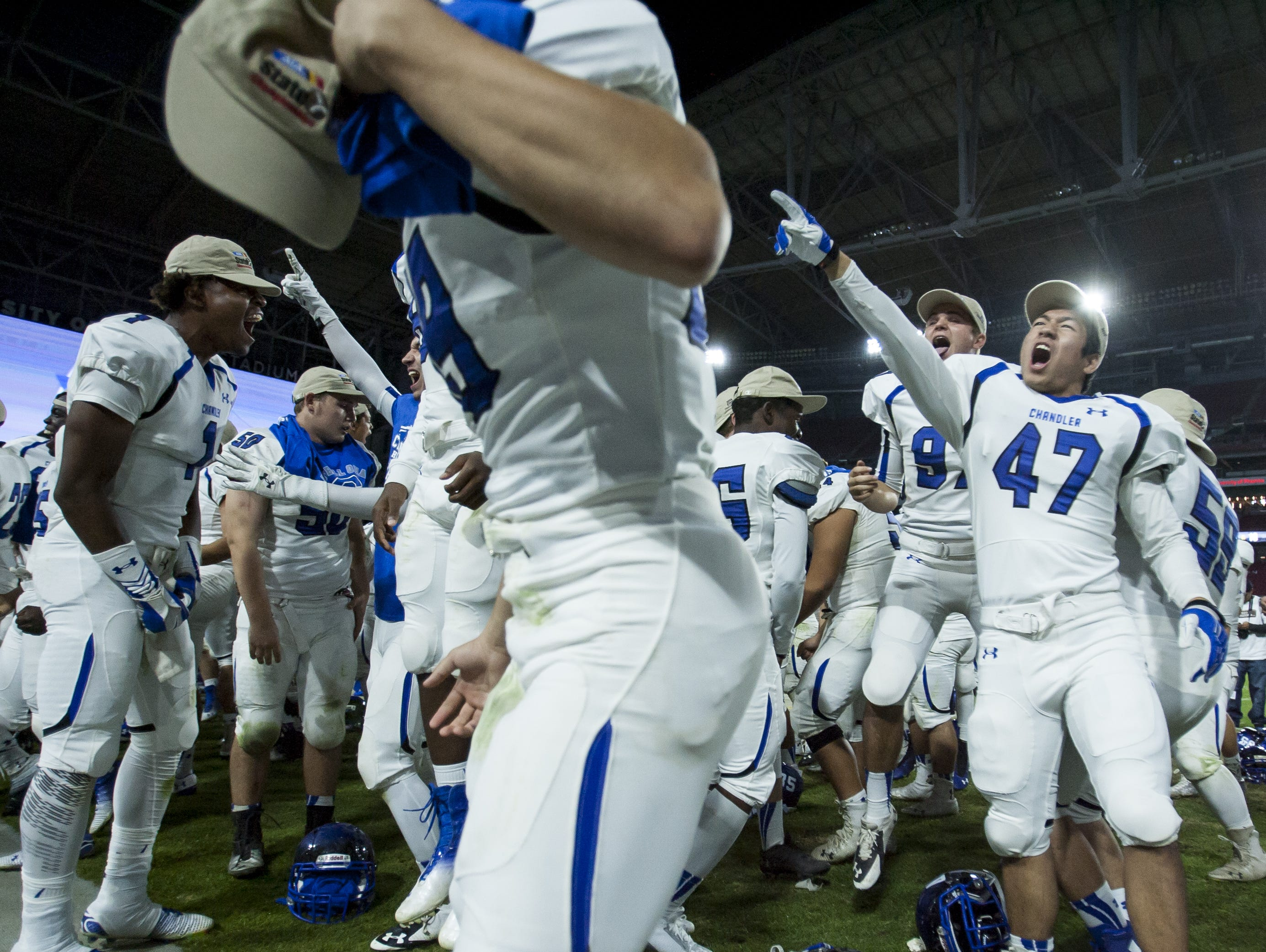 Chandler celebrates defeating Hamilton in the state championship game last season.