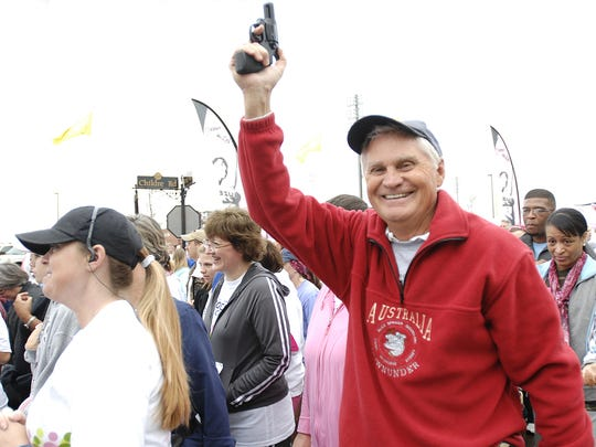 In this 2008 file photo, Paul Ott Carruth is shown shortly after the start of the Susan G. Komen Race for the Cure, of which he was honorary co-chairman.