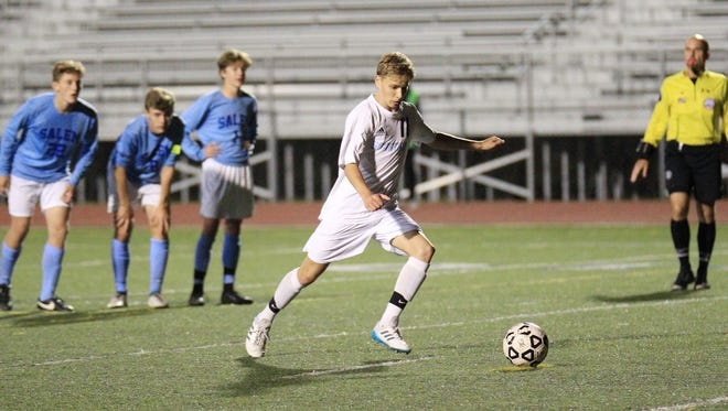 Livonia Stevenson's Tanner Brose approaches the ball as he gets set to score the tying goal on a penalty kick.