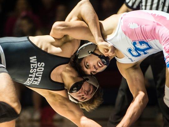 South Western's Ethan Baney, left, wrestles Spring