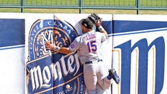 Scottsdale Scorpions outfielder Tim Tebow crashes into