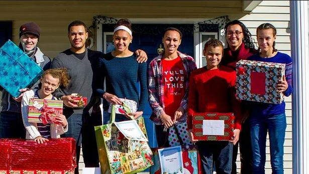 The Seidle family with gifts donated from the NAACP and APP.
