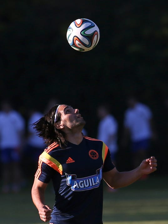 Colombia's player Radamel Falcao trains in Buenos Aires, Argentina, Wednesday, May 28, 2014. Colombia's national soccer team is hoping Falcao will be able to play at the World Cup after his knee injury. Brazil is hosting the international soccer tournament starting in June. (AP Photo/Sergio Llamera)