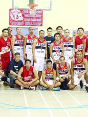 A combination of both the FSAG All-Stars and the PBA Powerade Tigers take agroup picture during halftime in this Sept. 25, 2011, file photo.