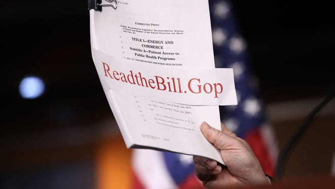 A copy of the Republican plan to replace the Affordable Care Act is show during a news conference at the U.S. Capitol on March 7, 2017.