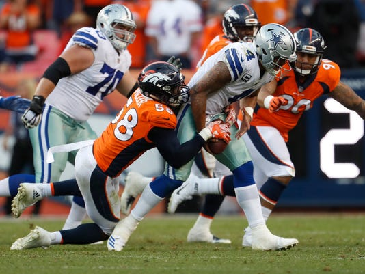 FILE - In this Sept. 17, 2017, file photo, Denver Broncos outside linebacker Von Miller (58) sacks Dallas Cowboys quarterback Dak Prescott (4) during an NFL football game, in Denver. While sack totals are usually about the individual, pass rushers and their coaches like to think getting the quarterback to the ground has a lot to do with what's going on around the sack stars. (AP Photo/Joe Mahoney, File)