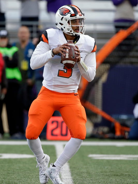 Oregon State quarterback Marcus McMaryion drops back to pass against Washington in the first half of an NCAA college football game Saturday, Oct. 22, 2016, in Seattle. (AP Photo/Elaine Thompson)