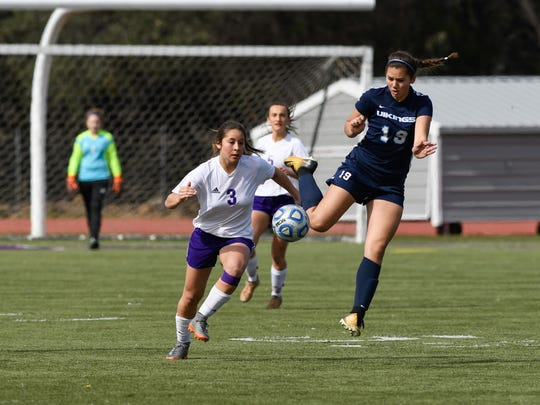 Shasta's Serena Elwood, left, runs with the ball alongside PV's Sofia Maldonado during the NSCIF Division I girls section championship in February of 2018.