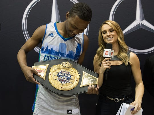 Texas A&M-Corpus Christi's Joseph Kilgore talks to an ESPN correspondent while holding the belt he won in the State Farm College Slam Dunk competition at the Bill Greehey Arena in San Antonio on Thursday, March 29, 2018.
