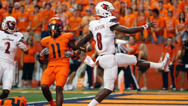 Louisville's Lamar Jackson high-steps into the end zone for a touchdown in the first quarter of an NCAA college football game against Syracuse in Syracuse, N.Y., Friday, Sept. 9, 2016. (AP Photo/Nick Lisi)