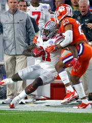 Ohio State Buckeyes wide receiver Parris Campbell (21) is brought down by Clemson Tigers safety Van Smith (23) during the first quarter of the College Football Playoff Semifinal game in the PlayStation Fiesta Bowl on Dec. 31, 2016 at University of Phoenix Stadium in Glendale, Arizona.