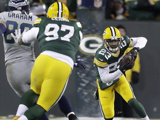 Damarious Randall looks for room to run after intercepting Seahawks quarterback Russell Wilson near the goal line before halftime.