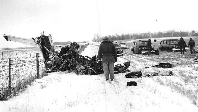 """*** DO NOT USE *** Officials survey the site near Clear Lake where a 1959 plane crash killed musicians Buddy Holly, Ritchie Valens, J.P. """"The Big Bopper"""" Richardson and pilot Roger Peterson."""