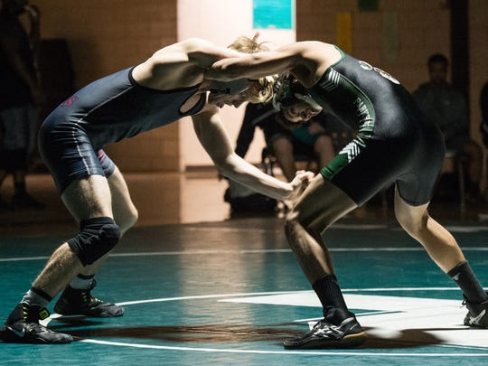 Snow Hill's Decklan Fisher, left, wrestles against