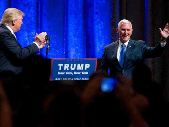 Republican presidential candidate Donald Trump (left) introduces Gov. Mike Pence during today's campaign event in Manhattan to officially introduce Pence as the vice presidential running mate.