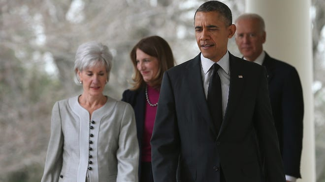 President Obama with outgoing Health and Human Services Secretary Kathleen Sebelius, left, her nominated replacement, Sylvia Mathews Burwell, and Vice President Biden in the Rose Garden at the White House Friday.