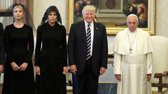 (Left to right:) Ivanka, Melania, and President Trump