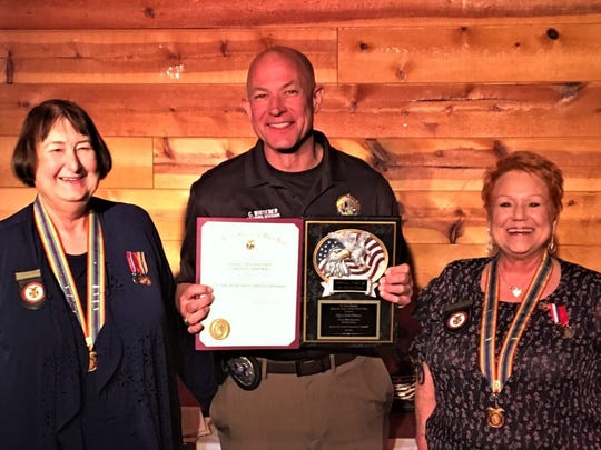 El Paso police Officer Curtis Whitener received the 2018 Law Enforcement Innovation Award presented by Paula Mitchell, left, and Pauline Ballesteros of the El Paso Chapter of the Military Order of the World Wars.