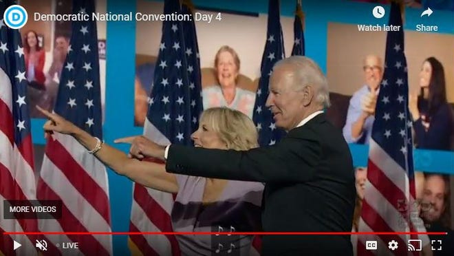 Joe and Jill Biden point to members of the virtual crowd who listened to his acceptance speech at the Democratic National Convention.