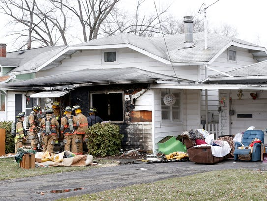 Fire crews remove furniture, rugs and other household