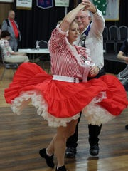 Bill Ellis and Stacie Lauscher, both of Antigo, square dance at the 55th Wisconsin Square & Round Dance Convention at the Central Wisconsin Convention & Expo Center in Rothschild, Sunday, August 10.