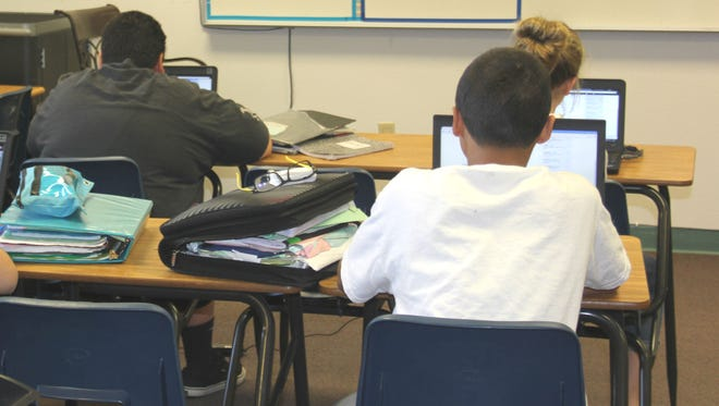 Children worked on writing essays during English on personal laptops at Charles Arthur Middle School.