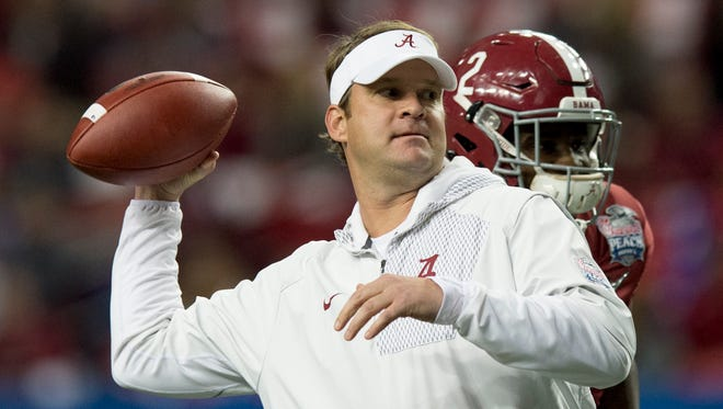 Alabama offensive coordinator Lane Kiffin throws passes as players warm up before the Peach Bowl in the Georgia Dome in Atlanta, Ga. on Saturday December 31, 2016.