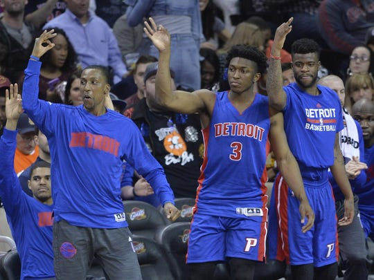 Players on the Pistons bench react after a three-point basket in the second quarter against the Cavaliers at Quicken Loans Arena on Wednesday.