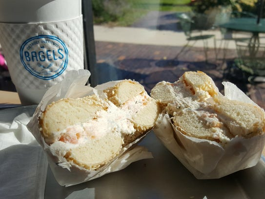 A sesame bagel with lox cream cheese from the Detroit
