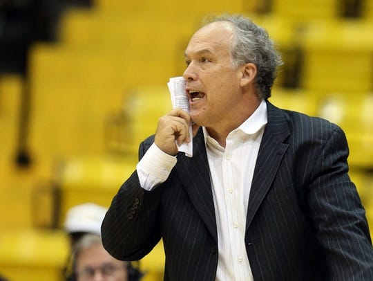 Southern Miss head coach Doc Sadler directs his team