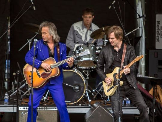 Jim Lauderdale, left, has had an enormously successful career as a songwriter but says there are still times when he feels like he's reaching for the bottom rung of success in the music business.