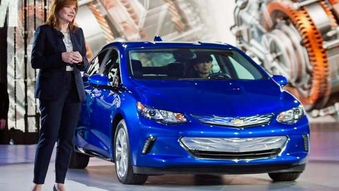 General Motors CEO Mary Barra talks about the 2016 Chevrolet Volt hybrid car at the North American International Auto Show, Monday, Jan. 12, 2015, in Detroit. (AP Photo/Tony Ding)
