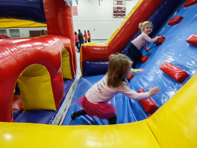 Youngsters race through a inflatable obstacle course