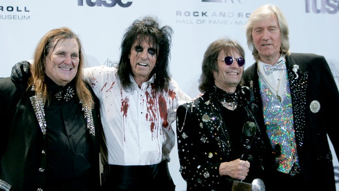 Alice Cooper, second from left, and his band appear backstage at the Rock and Roll Hall of Fame induction ceremony, Monday, March 14, 2011, in New York. (AP Photo)