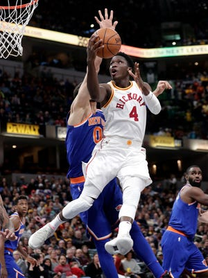 Indiana Pacers guard Victor Oladipo (4) shoots over New York Knicks center Enes Kanter (00) during the second half of an NBA basketball game in Indianapolis, Sunday, Feb. 11, 2018.