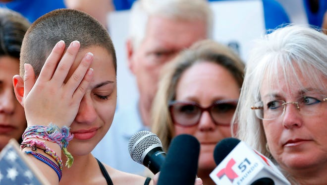"""Marjory Stoneman Douglas High School student Emma Gonzalez reacts during her speech at a rally for gun control at the Broward County Federal Courthouse in Fort Lauderdale, Fla. on February 17, 2018.A student survivor of the Parkland school shooting called out President Donald Trump on Saturday over his ties to the powerful National Rifle Association, in a poignant address to an anti-gun rally in Florida. """"To every politician taking donations from the NRA, shame on you!"""" said Emma Gonzalez, assailing Trump over the multi-million-dollar support his campaign received from the gun lobby -- and prompting the crowd to chant in turn: 'Shame on you!'"""