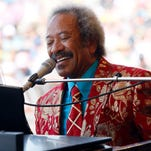 In this file photo dated Saturday, May 7, 2011, Allen Toussaint performs at the New Orleans Jazz and Heritage Festival in New Orleans, USA.  Legendary New Orleans musician Toussaint died after suffering a heart attack following a concert he performed in the Spanish capital, Madrid, after emergency services were called Monday Nov. 9, 2015, to his hotel.